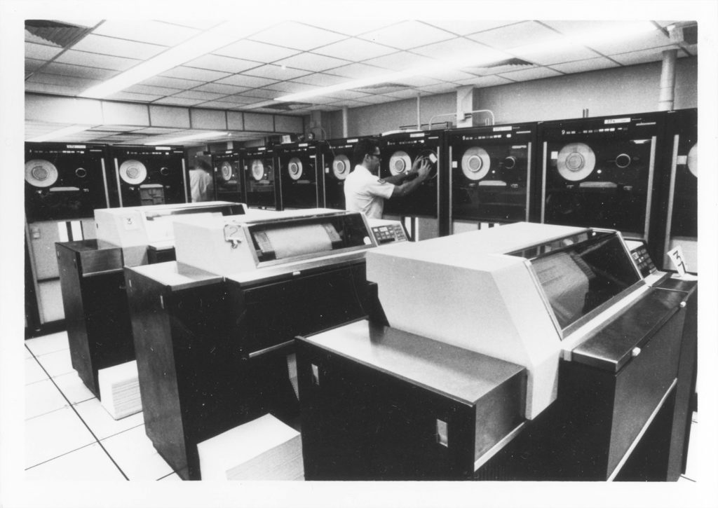 """Computers are used by specialists in NORAD Headquarters to keep track of information received daily."" Caption from U.S. Information Agency photo.  Source: National Archives, Still Pictures Branch, RG 306-PSE, box 79"